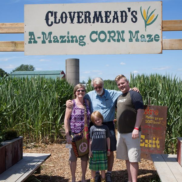 A Family standing in front of the Corn Maze entrance