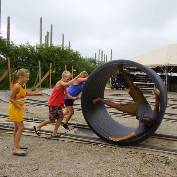 children playing with giant tube