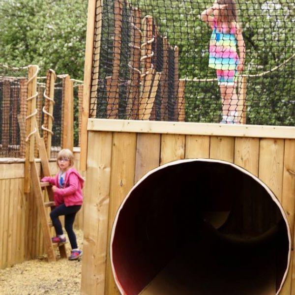 Girls playing in Ground Hog Hide n' Seek