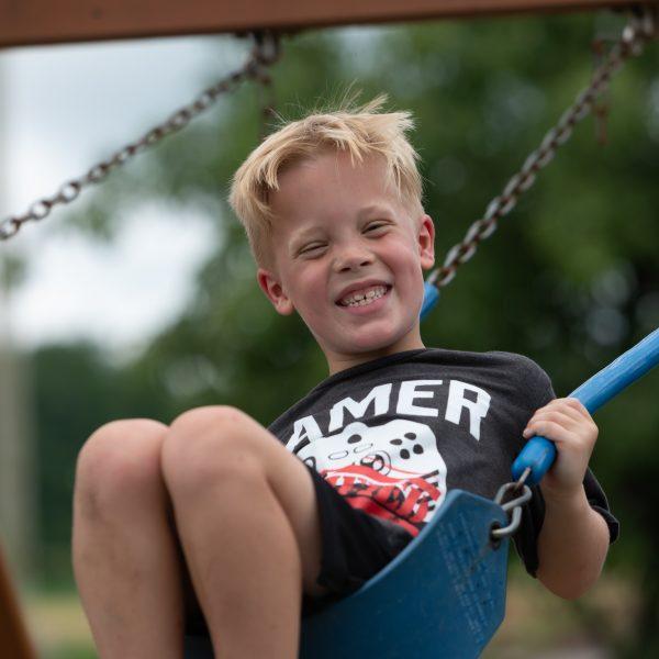 Boy swinging on the swing