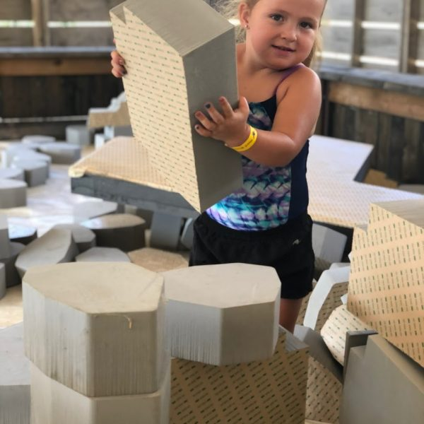 Girl building a tower in the Foam Pit