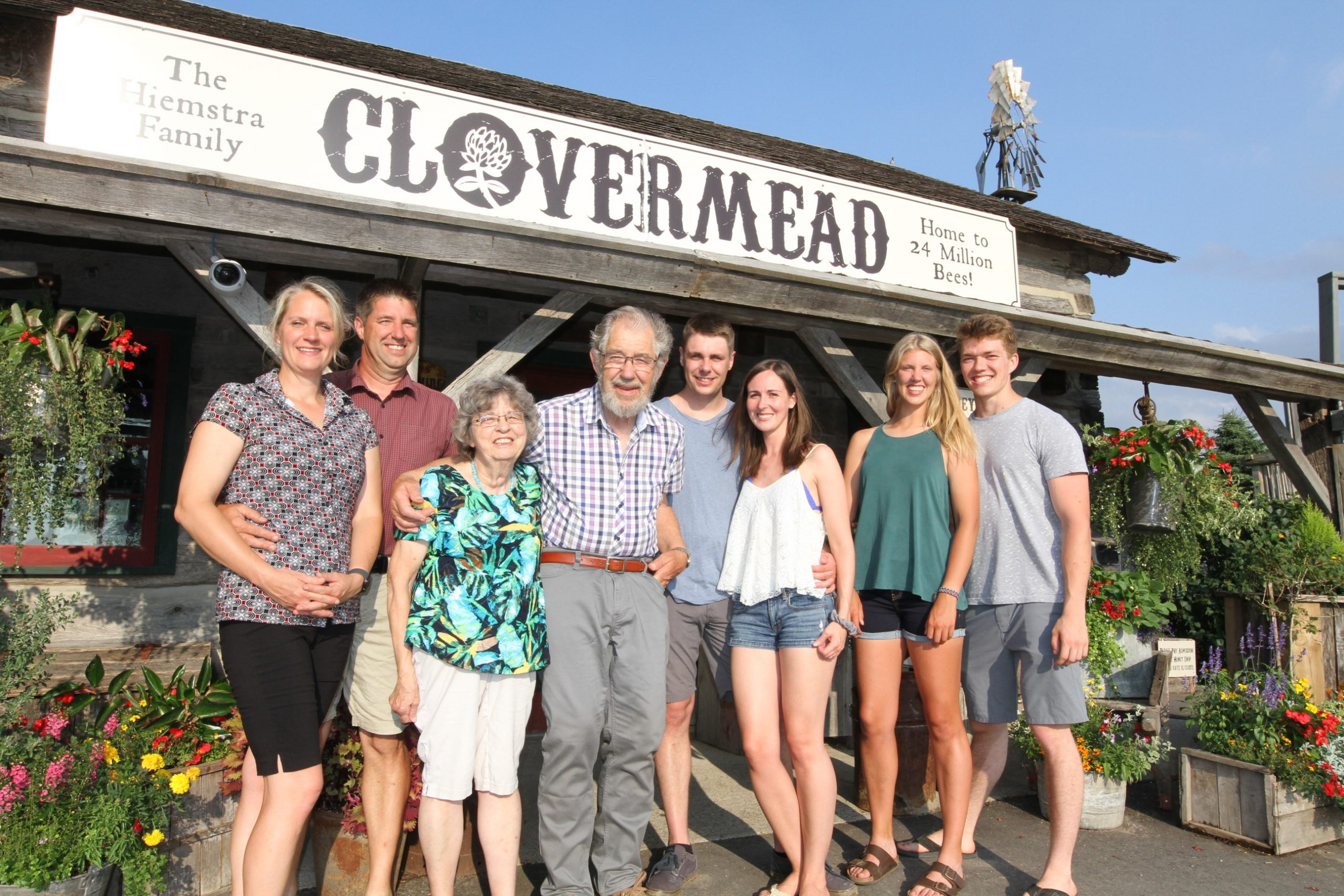 The Hiemstra Family standing in front of the Honey Shop
