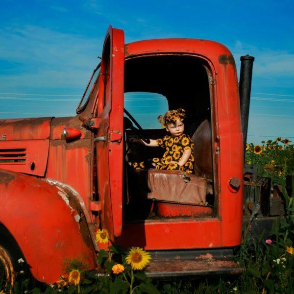 Girl posing inside old truck